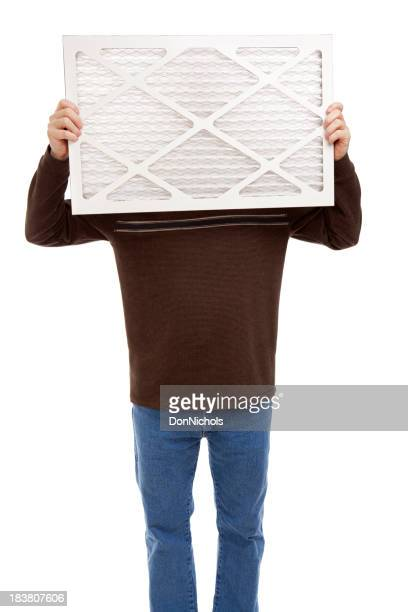 Man Holding a Furnace Air Filter
