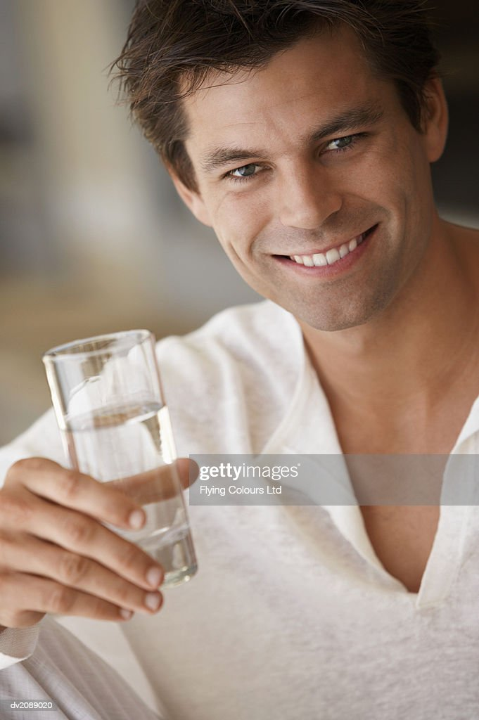 Man Holding a Glass of Water : Stock Photo