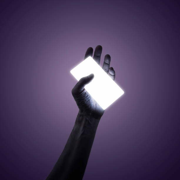 Man holding a glowing smart phone