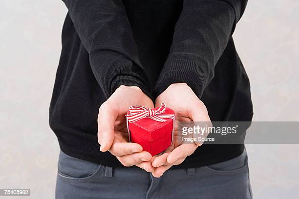 Man holding a heart shaped box