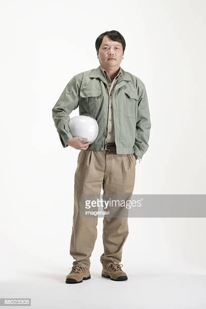 A man holding a helmet