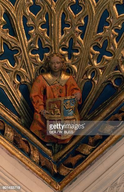 Man holding a heraldic shield relief in Belmonte castle Hill of San Cristobal Belmonte CastileLa Mancha Spain 15th century