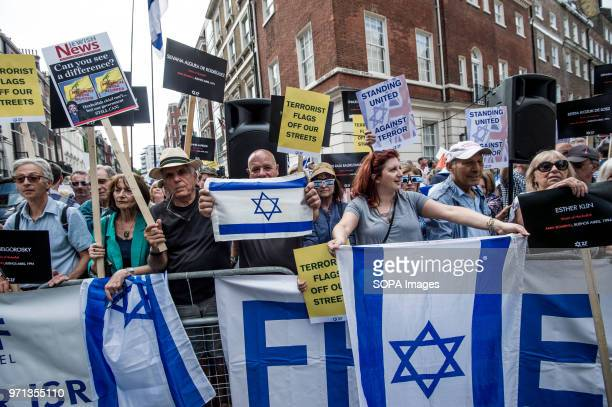 A man holding a Israel flag in the prozionist counterdemo Hundreds of antiIsrael protesters marched through the streets on the annual Al Quds Day...