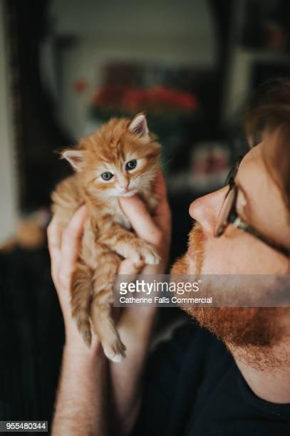 Man holding a kitten