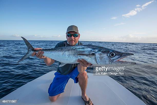 man holding a large fresh caught fish - big fish stock pictures, royalty-free photos & images