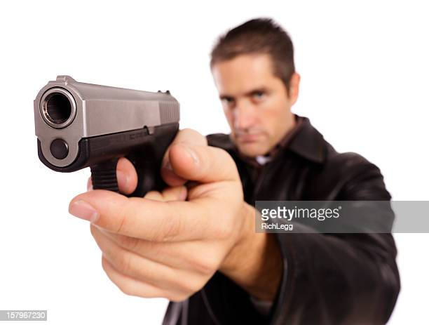man holding a large gun - trigger stock photos and pictures