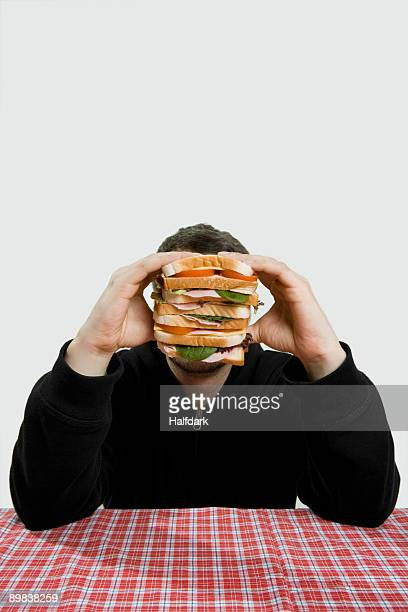 A man holding a large sandwich