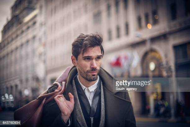Man holding a leather bag