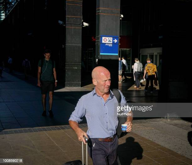 A man holding a luggage during a warm day in London on July 26 2018