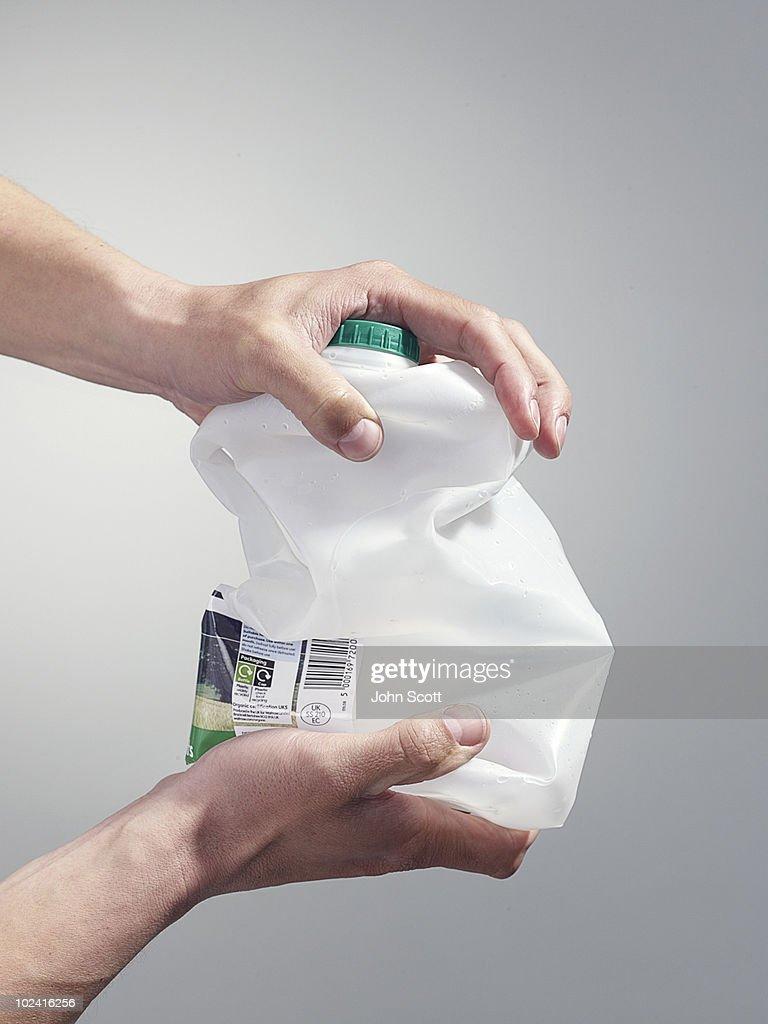 Man holding a milk carton for recycling : Stock Photo