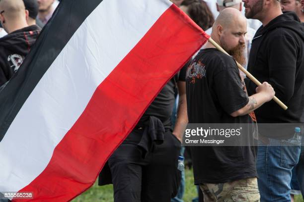 A man holding a nationalist flag is seen prior to a NeoNazi demonstration on August 19 2017 in Berlin Germany Some 1000 participants affiliated with...