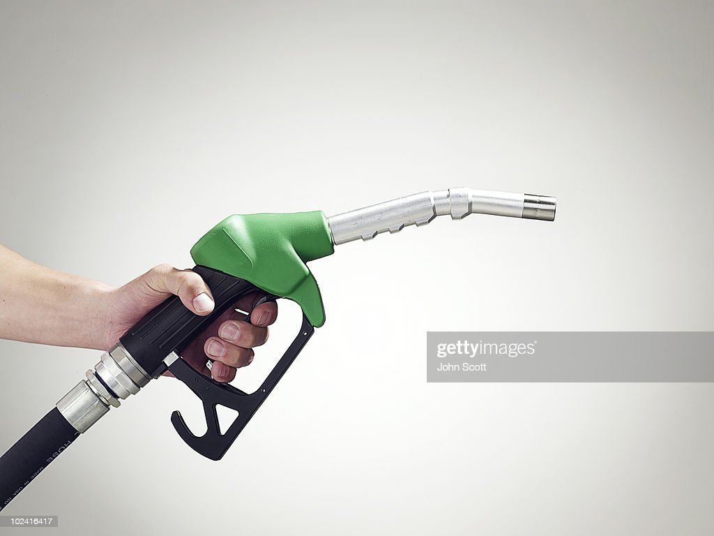 Man holding a petrol pump, close-up of hand : Stock-Foto