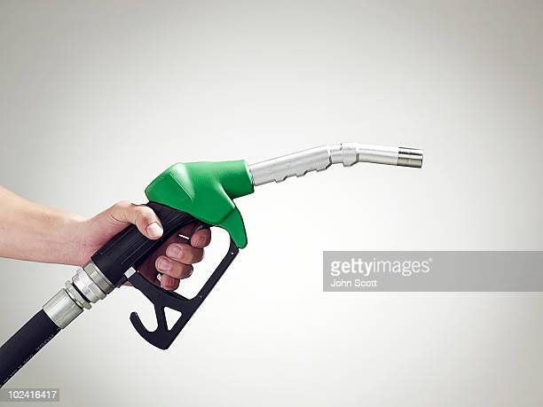 Man holding a petrol pump, close-up of hand