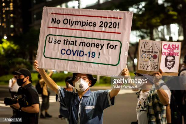 Man holding a placard marches during a demonstration against the forthcoming Tokyo Olympic Games on July 16, 2021 in Tokyo, Japan. Protesters...