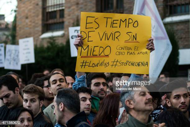 A man holding a placard that reads 'Is time to live without fear' during a protest against homosexual extermination in Chechnya in front of the...