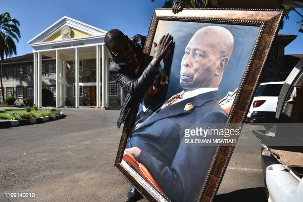 A man holding a portrait of the late former President of Kenya Daniel arap Moi in Nakuru on February 7 2020 The state funeral for Daniel Toroitich...