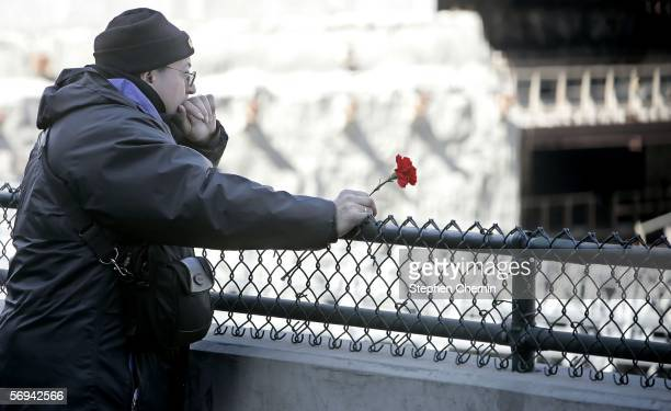 Man holding a red carnation ponders the site where the World Trade Center used to be February 26, 2006 in New York City. Today marks the 13th...