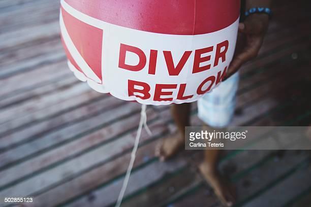man holding a scuba diver safety buoy - ilha de mabul imagens e fotografias de stock