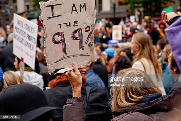 "man holding a sign that says ""i am the 99%"" - occupy wall street stock pictures, royalty-free photos & images"