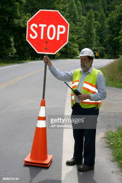A man holding a stop sign on Route 501