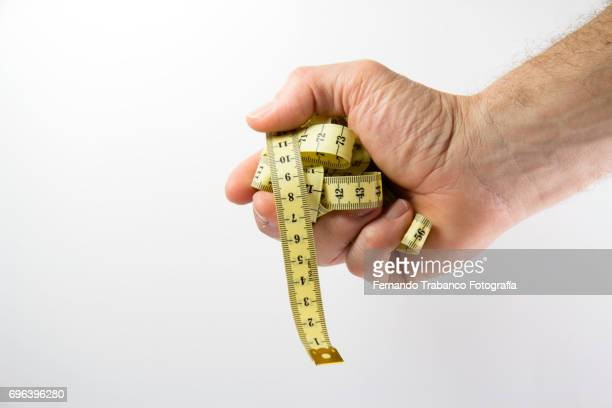 man holding a tape measure - measuring stock photos and pictures