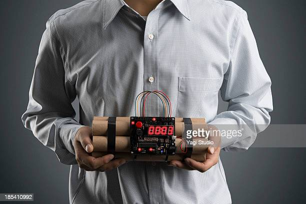 man holding a time bomb - time bomb stock photos and pictures