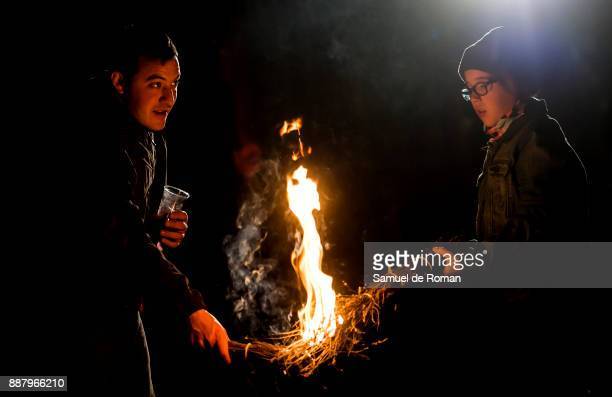 A man holding a torch during the Manas on December 7 2017 in Samaniego Spain 'Las Manas' is a traditional festival that is celebrated every year...