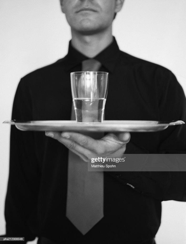 Man holding a tray, b&w. : Stockfoto