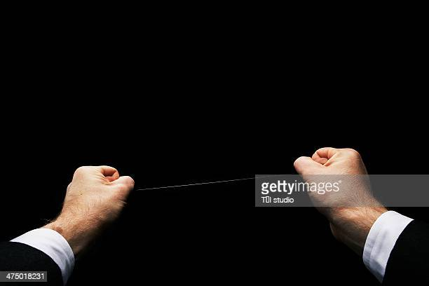 Man Holding A Wire