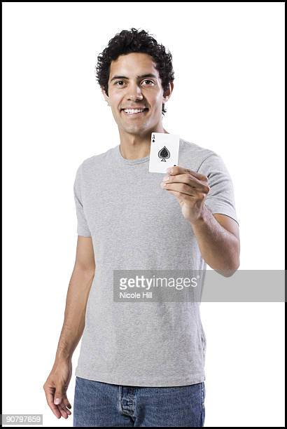 man holding an ace of spades