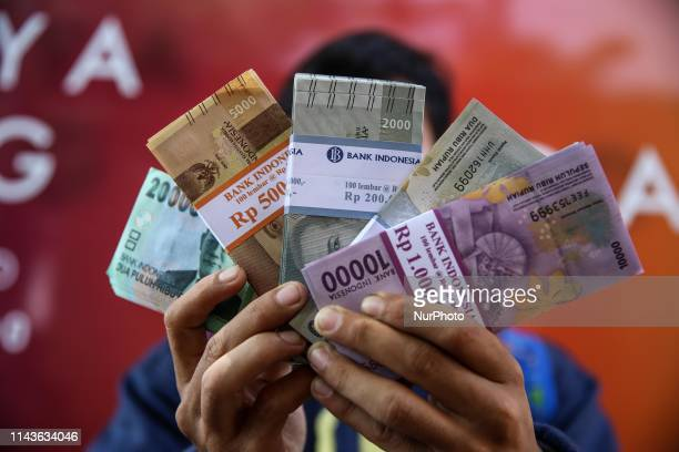 A man holding banknotes after exchange money as part of their preparations for Eid AlFitr in Jakarta Indonesia on May 14 2019 Eid alFitr celebrated...