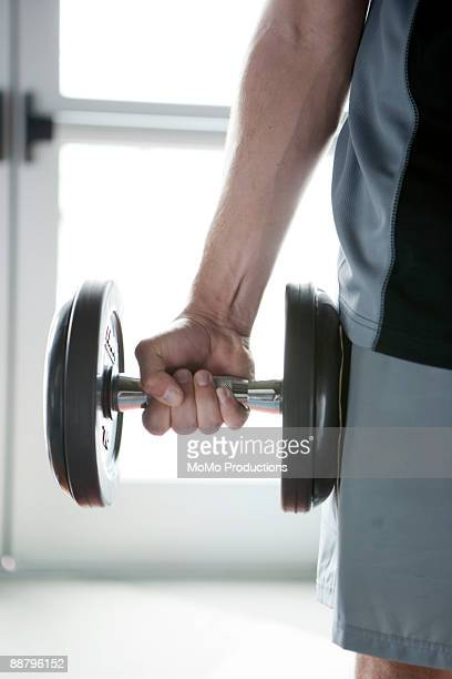 man holding barbell - momo challenge stock photos and pictures
