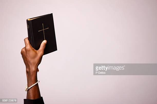 man holding bible - bibel bildbanksfoton och bilder