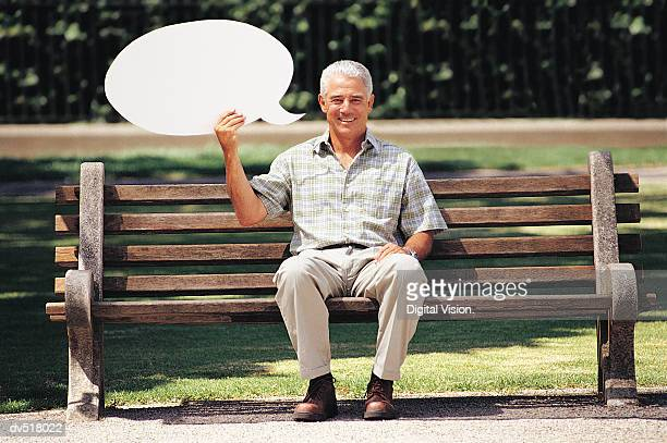 Man holding blank message bubbles