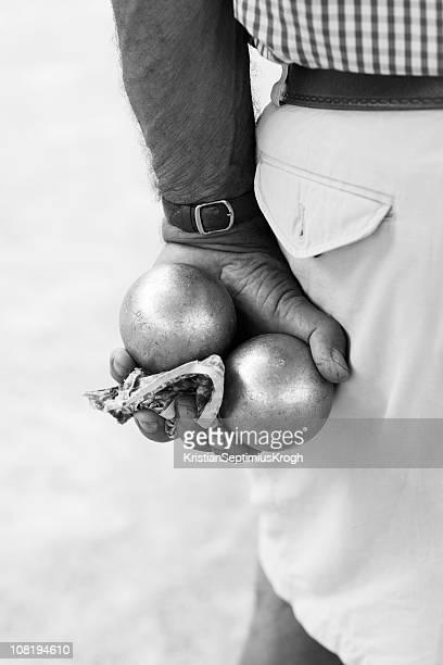 Man Holding Boule Balls