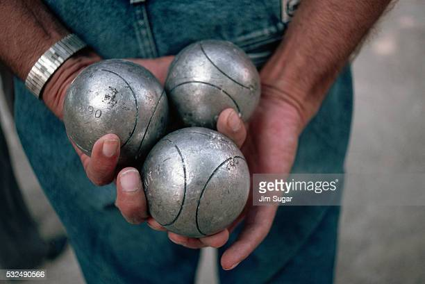 Man Holding Boules Balls