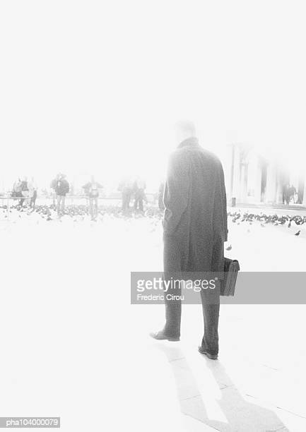 man holding briefcase, blurred, b&w - frock coat stock pictures, royalty-free photos & images