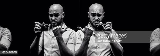 man holding camera - gesturing stock pictures, royalty-free photos & images