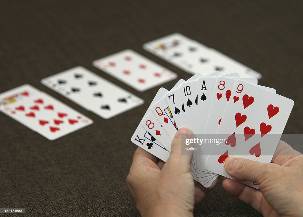 Man holding cards while playing bridge : Stock Photo