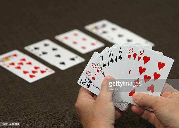 Man holding cards while playing bridge