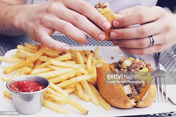 Man holding cheese steak
