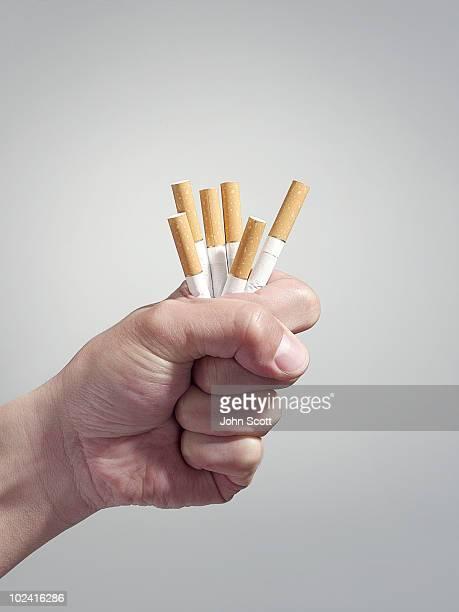 Man holding cigarettes