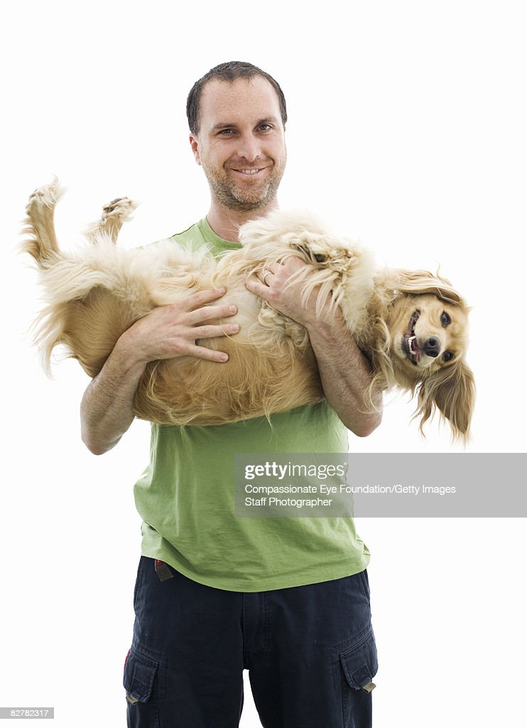 man holding cocker spaniel mix : Foto de stock