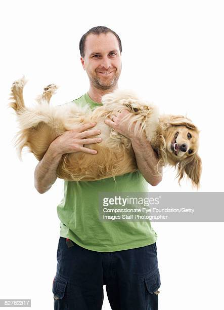 man holding cocker spaniel mix - spaniel stock photos and pictures