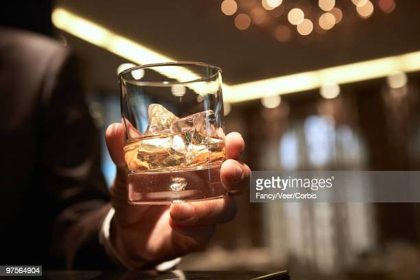 man holding cocktail - one man only stock pictures, royalty-free photos & images