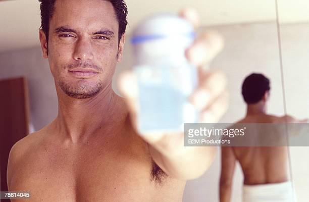 Man holding cologne