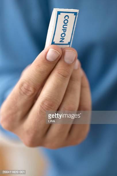 Man holding coupon