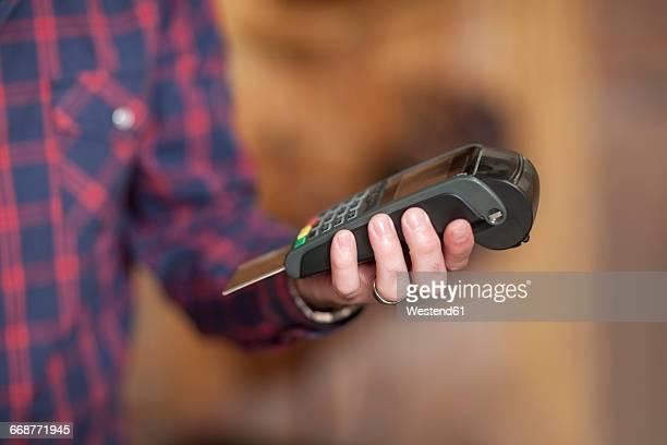 Man holding credit card reader