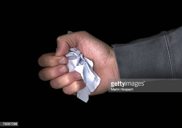 Man holding crumpled paper