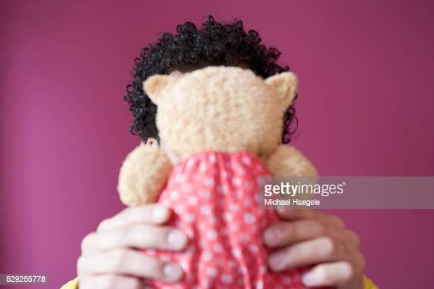 Man Holding Cuddle Toy
